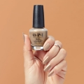 fall-ing-for-milan-nlmi01-nail-lacquer-99350047621-hand-and-bottle.jpg